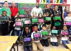 Pictured L-R  Principal James Rutherford, Buddy Nelms, Mayor Julian McTizic, Bobby Henderson,  Kenny Adkins, Warner Ross and 3rd Grade Teacher Stacy Moore and Bolivar Elementary 3rd Grade students.
