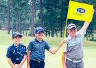 Daniel, far left, poses with the flagstick and his fellow competitors at Talamore.