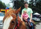 Even the young can enjoy the ride. Kaitlyn Howell takes one year old Cheyenne Phelps for a quick ride.