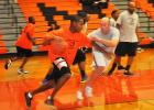 Former MHS basketball players Sherman Valentine (left) and Brent Dawkins (right) compete in the MHS Alumni Games.