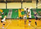 BCHS Lady Tiger Kyrayla Hunt (left) goes up for the kill as Leah Parks (background) and Becca Fulghum (right) ready to assist.