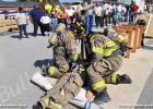 BFD Engineer Gary Wiggins II (left), Firefighter Nathan Kelso (right) and Junior Firefighter Devonte Smith (far right) demonstrate the Pittsburgh Drill.