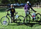Two grand prizes, bikes, were given away at the Family 5K Run/Walk Fitness Fun Day. Pictured (l-r): Kaleb Smeltser won a bike and helmet donated by Coordinated School Health Program and Debra Fuller won a bike donated by the Hardeman County Health Council through the Hardeman County Community Health Center.