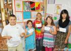 Pictured are student winners (l-r): Kindergarten through third grade winners Logan Kiestler, first place and Willow Arnold, third place and fourth through sixth grade winners Rane Moffitt, first place; Kaylee Hurst, second place; and Rebekah Sawyer, third place.