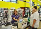 Pictured (l-r) are cashier Amber Bailey assisting customer Carla Vaughn.