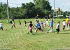 Children ages three to 18 attended the HRAYS soccer league clinic. Participants are shown practicing ball handling.